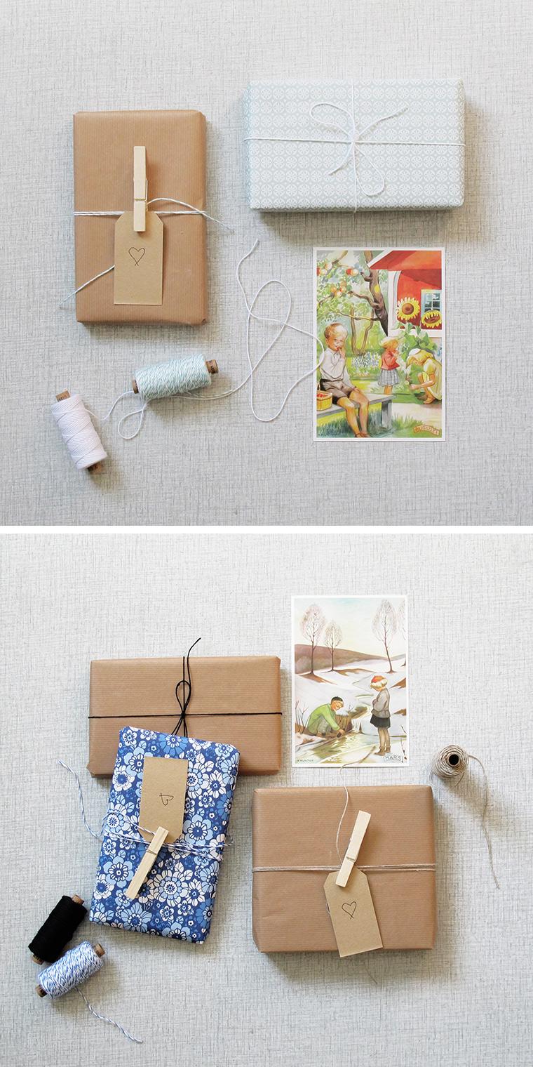 Presentinslagning med fina snören i bomull och lin, naturpapp tillsammans med vykort med Kerstin Frykstrands månadstavlor